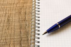 Pen with notebook on wooden table . Close up. Concept of educati stock photos