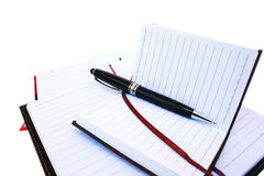 Pen and notebooks Stock Photos