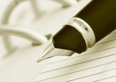 Pen on notegook. Close-up of pen on notegook Stock Photos