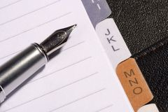 Pen and Notepad Stock Photography