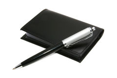 Pen and notepad. On a white background Royalty Free Stock Image