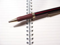 Pen and notepad. Pen over a notepad and isolated Royalty Free Stock Images