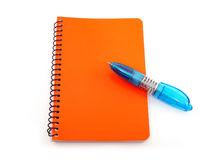 Pen and Notepad. A blue pen and red notepad on a white background Royalty Free Stock Photo