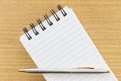 Pen and notepad with blank page Stock Photography