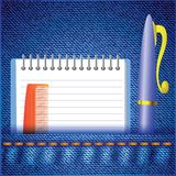 Pen and notepad on a jeans background Stock Image