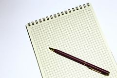 Pen and notepad for notes on a white background. Stock Photo