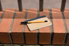Pen and notepad outside Royalty Free Stock Photo