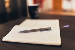 Pen on Notepad Paper Royalty Free Stock Photo