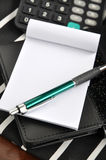 Pen on notepad Stock Photography