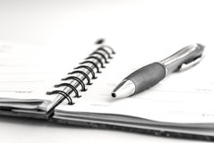 Pen. And notepad on white background stock photo