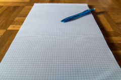 Pen and notepad. A pen and notepad on a wooden floor Stock Photos