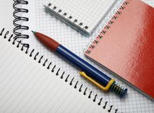 Pen on notepads. Colorful pen on notepads as a background Stock Photography