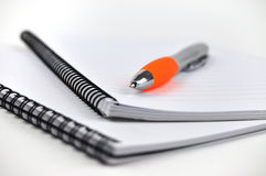 Pen and Notepads in Blue Royalty Free Stock Photography