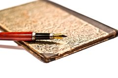 Pen old. Black and gold fountain pen, ink pen on old aged paper Royalty Free Stock Image