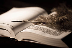 Pen on old book. Royalty Free Stock Photos