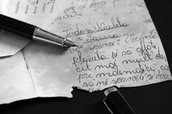 Pen on the old letter. A letter written in 1977 by a student to the math teacher. Text written in Romanian Stock Photos