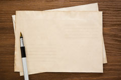 Pen and old postal envelope Royalty Free Stock Image