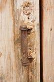 Pen on an old wooden door Stock Photo