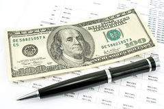 Pen and one hundred dollar bill Royalty Free Stock Image