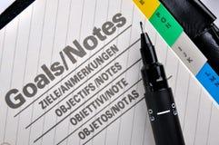 Pen op doelstellingen pagina Stock Afbeeldingen