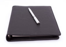 Pen op notitieboekje Stock Foto's