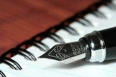 Pen op notitieboekje royalty-vrije stock afbeelding
