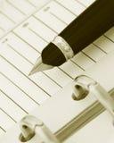 Pen op Notitieboekje (y) Stock Foto