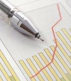 Pen op Positieve het Verdienen Grafiek Stock Foto