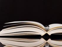 Pen in Open Book Stock Photo