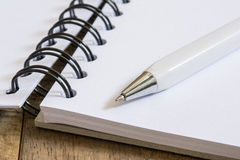 Pen on open book Stock Photography
