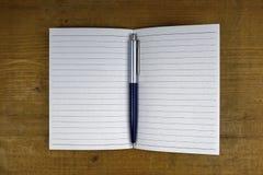 Pen on open empty notebook Royalty Free Stock Photo