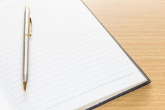 Pen and open note book with blank page Royalty Free Stock Images