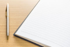 Pen and open note book with blank page Royalty Free Stock Photo