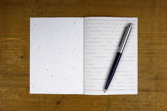 Pen on open notebook Stock Photography