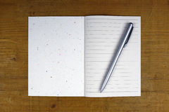 Pen on open notebook Royalty Free Stock Photography