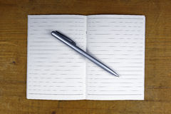 Pen on open notebook Royalty Free Stock Images