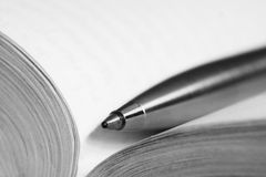 Pen on a opened book Stock Image