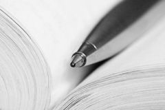 Pen on a opened book Stock Photography