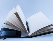 Pen on opened diary Royalty Free Stock Image