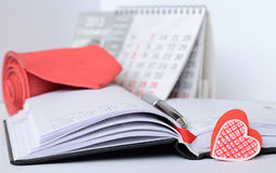 Pen on an opened notebook. With heart shaped bookmark Stock Photography