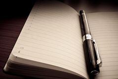 Pen on organizer / agenda Royalty Free Stock Image