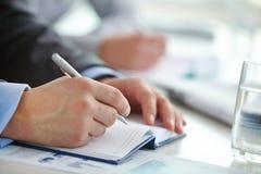 Pen over blocnotepagina Stock Afbeelding