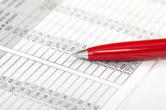 Pen over business chart Stock Images