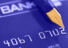 Pen over credit card Stock Images