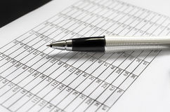 Pen over data sheet Royalty Free Stock Photos