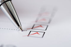 Pen Over Filled Checkboxes Stock Photography