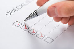 Pen Over Filled Checkboxes. Close-up Of Silver Pen Over Filled Checkboxes In Form Royalty Free Stock Photos