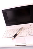 Pen over laptop Royalty Free Stock Images