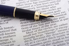 Pen Over Newspaper Royalty Free Stock Photo