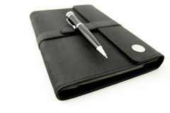 Pen over note book Royalty Free Stock Photography